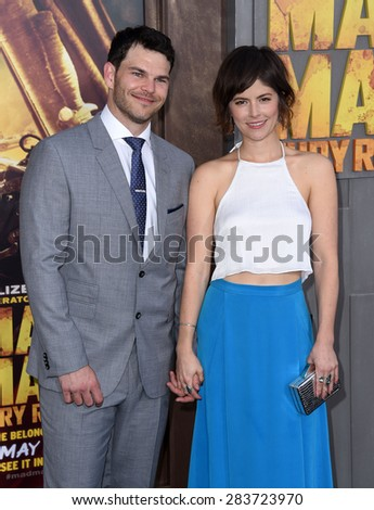 """LOS ANGELES - MAY 07:  Josh Helman & Jennifer Allcott arrives to the """"Mad Max: Fury Road"""" Los Angeles Premiere  on May 7, 2015 in Hollywood, CA                 - stock photo"""