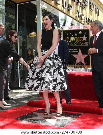 LOS ANGELES - MAY 1:  Julianna Margulies at the Julianna Margulies Hollywood Walk of Fame Star Ceremony at the Hollywood Boulevard on May 1, 2015 in Los Angeles, CA - stock photo