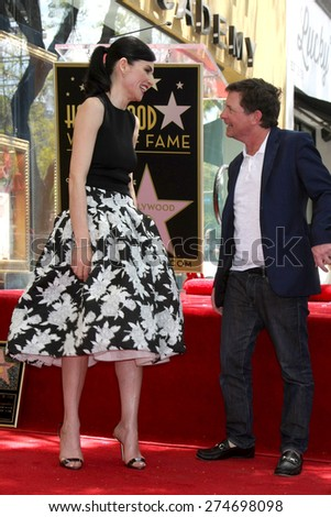 LOS ANGELES - MAY 1:  Julianna Margulies, Michael J. Fox at the Julianna Margulies Hollywood Walk of Fame Star Ceremony at the Hollywood Boulevard on May 1, 2015 in Los Angeles, CA - stock photo