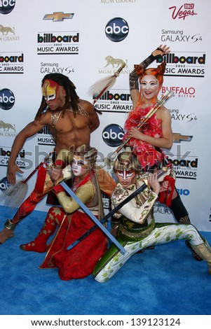 LOS ANGELES -  MAY 19:  Ka Performers from Cirque du Soliel arrives at the Billboard Music Awards 2013 at the MGM Grand Garden Arena on May 19, 2013 in Las Vegas, NV - stock photo