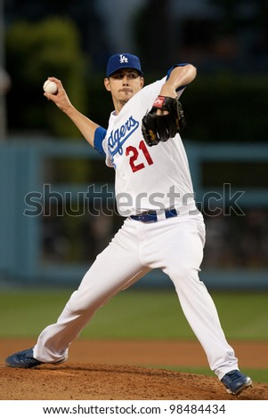 LOS ANGELES - MAY 16: Los Angeles Dodgers P Jon Garland #21 pitches during the Major League Baseball game on May 16 2011 at Dodger Stadium in Los Angeles. - stock photo