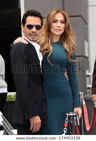 LOS ANGELES - MAY 23:  Marc Anthony & Jennifer Lopez arrives to the Walk of Fame Ceremony for Simon Fuller  on May 23, 2011 in Hollywood, CA