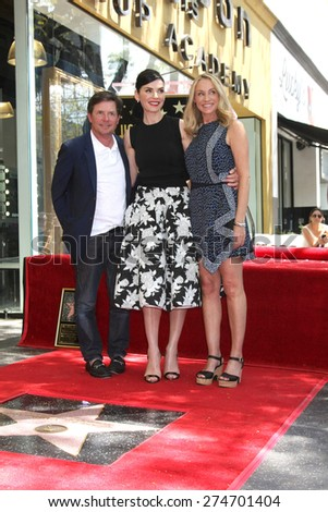 LOS ANGELES - MAY 1:  Michael J. Fox, Julianna Margulies, Tracy Pollan at the Julianna Margulies Hollywood Walk of Fame Star Ceremony at the Hollywood Boulevard on May 1, 2015 in Los Angeles, CA - stock photo