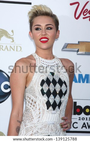LOS ANGELES -  MAY 19:  Miley Cyrus arrives at the Billboard Music Awards 2013 at the MGM Grand Garden Arena on May 19, 2013 in Las Vegas, NV - stock photo