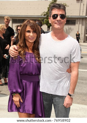 "LOS ANGELES - MAY 08:  Paula Abdul & Simon Cowel arrives to the ""X-Factor"" LA Auditions  on May 08,2011 in Los Angeles, CA"