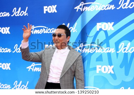 LOS ANGELES - MAY 16:  Psy arrives at the American Idol Season 12 Finale at the Nokia Theater at LA Live on May 16, 2013 in Los Angeles, CA - stock photo