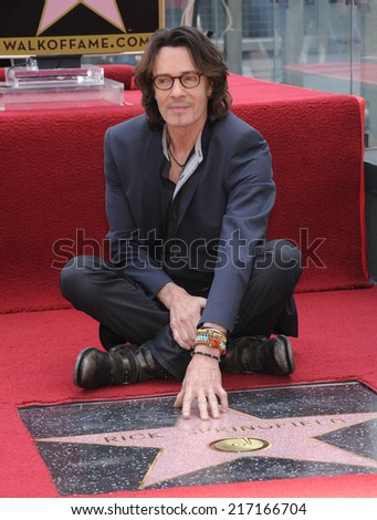 LOS ANGELES - MAY 09:  Rick Springfield arrives to the Walk of Fame Honors Rick Springfield  on May 09, 2014 in Hollywood, CA.                 - stock photo