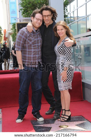 LOS ANGELES - MAY 09:  Rick Springfield, Barbara Porter & Joshua Bowman Springthorpe arrives to the Walk of Fame Honors Rick Springfield  on May 09, 2014 in Hollywood, CA.                 - stock photo