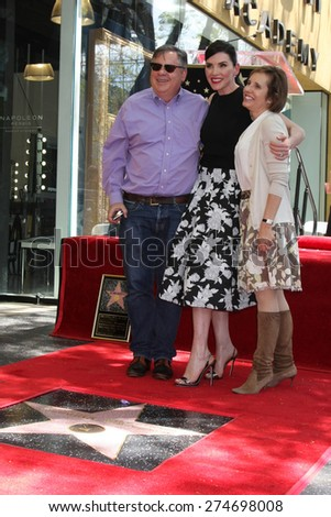 LOS ANGELES - MAY 1:  Robert King, Julianna Margulies, Michelle King at the Julianna Margulies Hollywood Walk of Fame Star Ceremony at the Hollywood Boulevard on May 1, 2015 in Los Angeles, CA - stock photo