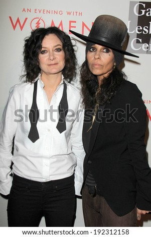 """LOS ANGELES - MAY 10:  Sara Gilbert, Linda Perry at the L.A. Gay & Lesbian Center's """"An Evening With Women"""" at Beverly Hilton Hotel on May 10, 2014 in Beverly Hills, CA - stock photo"""