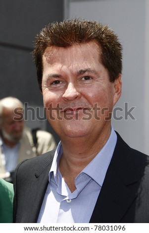 LOS ANGELES - MAY 23: Simon Fuller at a ceremony where Simon Fuller receives a star on the Hollywood Walk of Fame in Los Angeles, California on May 23, 2011. - stock photo