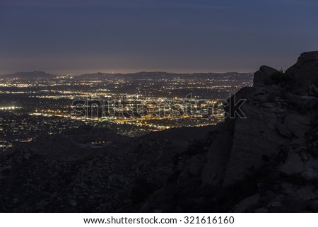 Los Angeles mountain view of the San Fernando Valley from the rugged rock formations in Rocky Peak Park.   - stock photo