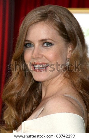 "LOS ANGELES - NOV 12:  Amy Adams arrive at the ""Muppets"" World Premiere at El Capitan Theater on November 12, 2011 in Los Angeles, CA - stock photo"