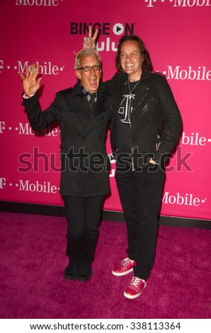 LOS ANGELES - NOV 10:  Andy Dick, John Legere at the T-Mobile Un-carrier X Launch Celebration at the Shrine Auditorium on November 10, 2015 in Los Angeles, CA - stock photo
