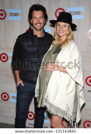 LOS ANGELES - NOV 12:  Blake Mycoskie & Heather Mycoskie arrives to the TOMS for Target Partnership Celebration on November 12, 2014 in Culver City, CA                 - stock photo