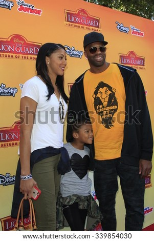 "LOS ANGELES - NOV 14:  Candace Parker, Lailaa, Shelden Williams at the ""The Lion Guard: Return Of The Roar"" Screening at the Walt Disney Studios on November 14, 2015 in Burbank, CA - stock photo"