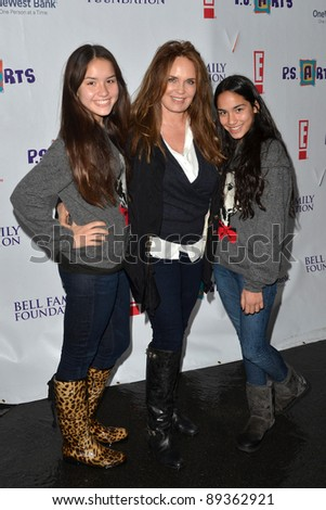 "LOS ANGELES - NOV 20:  Catherine Bach and daughters arrives at the P.S Arts 2011 ""Express Yourself"" Event at Barker Hanger on November 20, 2011 in Santa Monica, CA"