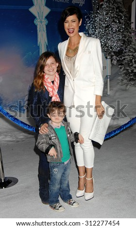LOS ANGELES - NOV 19:  Catherine Bell and family arrives at the Frozen World Premiere  on November 19, 2013 in Los Angeles, CA                 - stock photo