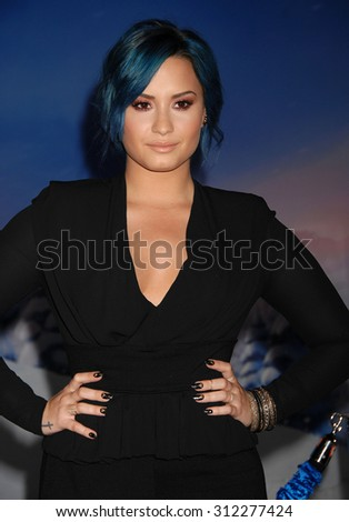 LOS ANGELES - NOV 19:  Demi Lovato arrives at the Frozen World Premiere  on November 19, 2013 in Los Angeles, CA                 - stock photo