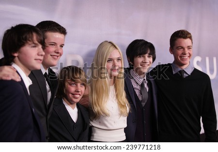 """LOS ANGELES - NOV 22:  ELLE FANNING & CAST arrives to the """"Super 8"""" DVD Launch  on November 22, 2011 in Beverly Hills, CA                 - stock photo"""