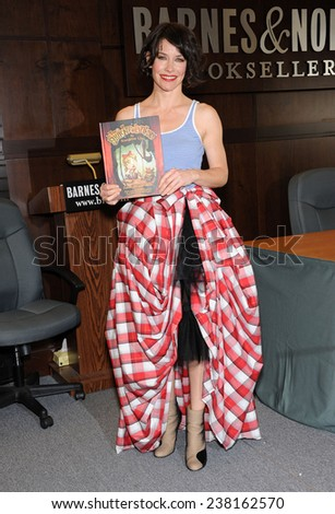 """LOS ANGELES - NOV 22:  Evangeline Lilly arrives to the Evangeline Lilly signs new book """"The Squicker Wonkers"""" on November 22, 2014 in Los Angeles, CA                 - stock photo"""