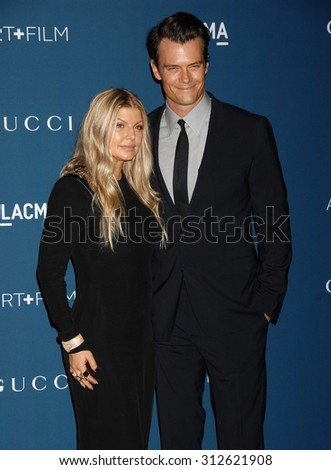 LOS ANGELES - NOV 2:  Fergie and husband Josh Duhamel arrives at the LACMA 2013 Art and Film Gala  on November 2, 2013 in Los Angeles, CA