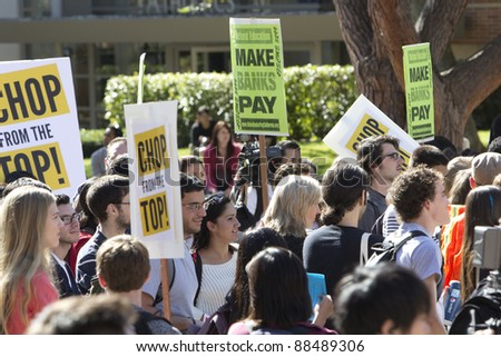 LOS ANGELES - NOV 9:  Hundreds of students and workers rally at UCLA on November 9, 2011 in Los Angeles. Refund California organized the event as part of the Occupy Wall Street movement. - stock photo