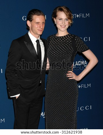 LOS ANGELES - NOV 2:  Jamie Bell and wife Evan Rachel Wood arrives at the LACMA 2013 Art and Film Gala  on November 2, 2013 in Los Angeles, CA                 - stock photo