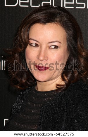 LOS ANGELES - NOV 2:  Jennifer Tilly arrives at the Decades Denim Fashion Show at Private Home on November 2, 2010 in Beverly HIlls, CA
