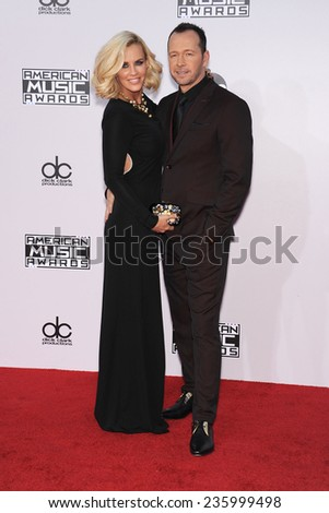 LOS ANGELES - NOV 23:  Jenny McCarthy & Donnie Wahlberg arrives to the 2014 American Music Awards on November 23, 2014 in Los Angeles, CA                 - stock photo