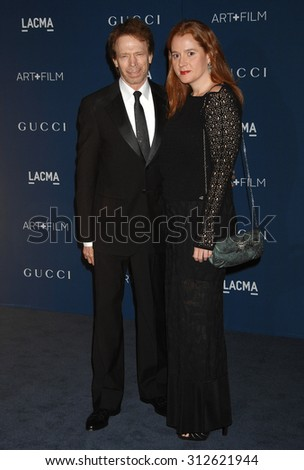 LOS ANGELES - NOV 2:  Jerry Bruckheimer and Alexandra Balahoutis arrives at the LACMA 2013 Art and Film Gala  on November 2, 2013 in Los Angeles, CA