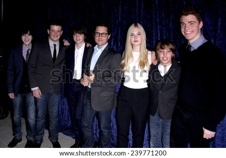 """LOS ANGELES - NOV 22:  JJ ABRAMS, ELLE FANNING & CAST arrives to the """"Super 8"""" DVD Launch  on November 22, 2011 in Beverly Hills, CA                 - stock photo"""
