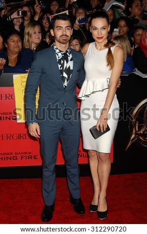LOS ANGELES - NOV 18:  Joe Jonas and Blanda Eggenschwiler arrives at the The Hunger Games Catching Fire US Premiere  on November 18, 2013 in Los Angeles, CA                 - stock photo