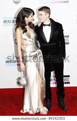 LOS ANGELES - NOV 20: Justin Bieber; Selena Gomez at the 2011 American Music Awards held at Nokia Theatre L.A. Live on November 20, 2011 in Los Angeles, California - stock photo