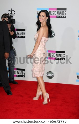 LOS ANGELES - NOV 21:  Katy Perry arrives at the 2010 American Music Awards at Nokia Theater on November 21, 2010 in Los Angeles, CA - stock photo