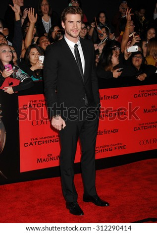 LOS ANGELES - NOV 18:  Liam Hemsworth arrives at the The Hunger Games Catching Fire US Premiere  on November 18, 2013 in Los Angeles, CA                 - stock photo