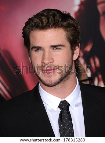 """LOS ANGELES - NOV 18:  Liam Hemsworth arrives to the """"The Hunger Games: Catching Fire"""" Los Angeles Premiere  on November 18, 2013 in Los Angeles, CA                 - stock photo"""