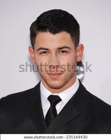 LOS ANGELES - NOV 23:  Nick Jonas arrives to the 2014 American Music Awards on November 23, 2014 in Los Angeles, CA                 - stock photo