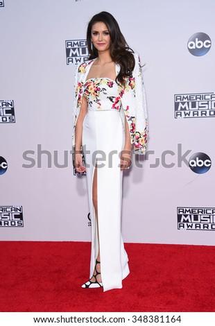 LOS ANGELES - NOV 22:  Nina Dobrev arrives to the American Music Awards 2015  on November 22, 2015 in Los Angeles, CA.                 - stock photo