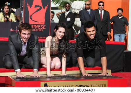 LOS ANGELES - NOV 3: Robert Pattinson, Kristen Stewart and Taylor Lautner attends the Hand and Footprint Ceremony at Grauman's Chinese Theater on November 3, 2011 in Los Angeles, California - stock photo
