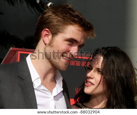 LOS ANGELES - NOV 3:  Robert Pattinson, Kristen Stewart at the Handprint and Footprint Ceremony for the Twilight Saga Actors at Grauman's Chinese Theater on November 3, 2011 in Los Angeles, CA - stock photo