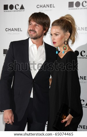 "LOS ANGELES - NOV 13:  Rodger Berman, Rachel Zoe arrive at the MOCA's Annual Gala ""The Artist's Museum Happening"" 2010 at Museum of Contemporary Art on November 13, 2010 in Los Angeles, CA - stock photo"
