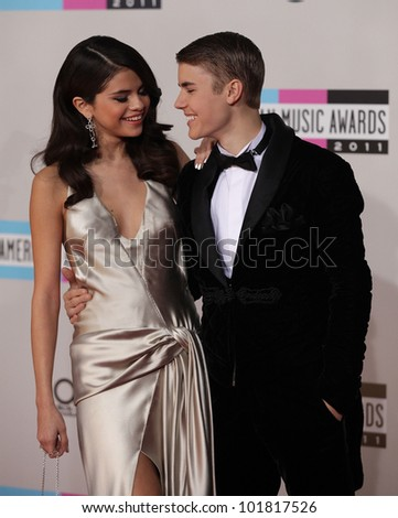 LOS ANGELES - NOV 20:  Selena Gomez & Justin Bieber arrives to the American Music Awards 2011  on November 20, 2011 in Los Angeles, CA
