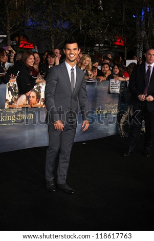 "LOS ANGELES - NOV 12:  Taylor Lautner arrive to the 'The Twilight Saga: Breaking Dawn - Part 2"" Premiere at Nokia Theater on November 12, 2012 in Los Angeles, CA"