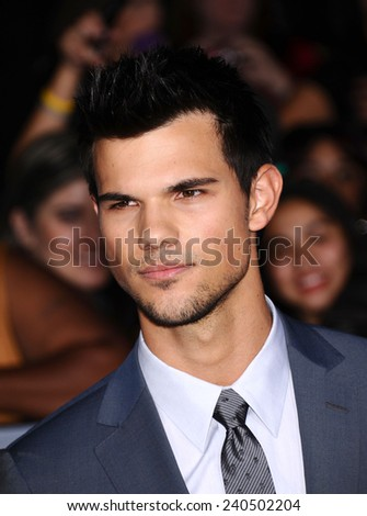 "LOS ANGELES - NOV 11:  Taylor Lautner arrives to the ""The Twilight Saga: Breaking Dawn-Part 2"" World Premiere  on November 11, 2012 in Los Angeles, CA                 - stock photo"