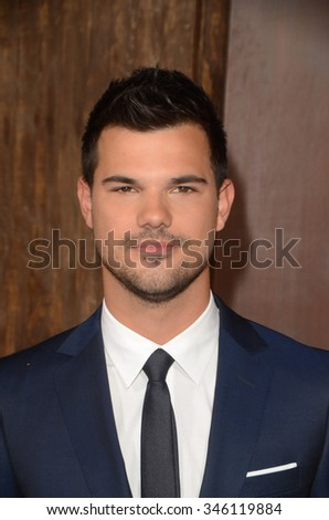 """LOS ANGELES - NOV 30:  Taylor Lautner at the """"The Ridiculous 6"""" Los Angeles Premiere at the AMC Universal City Walk on November 30, 2015 in Los Angeles, CA - stock photo"""