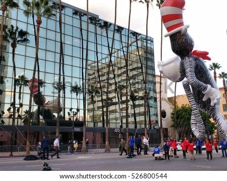 LOS ANGELES, NOV 27TH, 2016: A Cat in the Hat balloon floats next to its reflection in the mirrored windows of an office building along Hollywood Boulevard during the 85th Hollywood Christmas Parade.