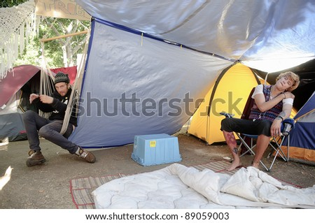 LOS ANGELES - NOVEMBER 14: Unidentified men protesters at Occupy LA camping village against the City Hall in Los Angeles on November 14, 2011.