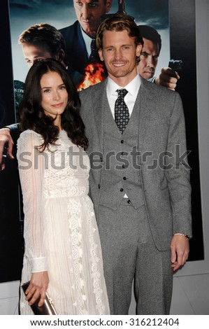 LOS ANGELES - OCT 4:  Abigail Spencer and Josh Pence arrives at the Gangster Squad World Premiere  on January 7, 2013 in Hollywood, CA              - stock photo