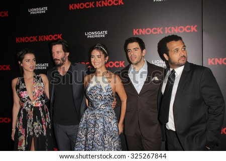 """LOS ANGELES - OCT 7:  Ana de Armas, Keanu Reeves, Lorenza Izzo, unknown Eli Roth at the """"Knock Knock"""" Los Angeles Premiere at the TCL Chinese 6 Theaters on October 7, 2015 in Los Angeles, CA - stock photo"""